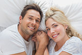 High angle portrait of a couple lying in bed