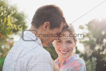 Smiling young couple in park