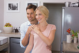 Happy loving couple standing in the kitchen
