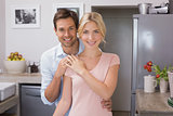 Portrait of a happy loving young couple in kitchen