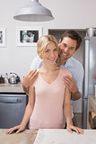 Happy loving young couple in the kitchen
