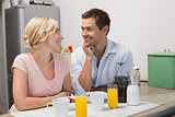 Couple looking at each other at breakfast table