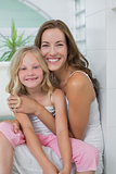 Portrait of a smiling mother and daughter