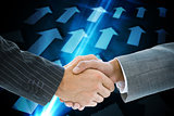 Composite image of business handshake against blue