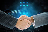 Composite image of business handshake against technical