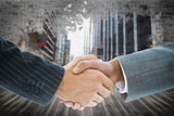 Composite image of business handshake against cityscape