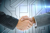 Composite image of business handshake against circuit board