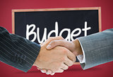 Composite image of business handshake against budget