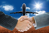 Composite image of business handshake against 3D plane
