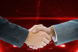 Composite image of business handshake against red background