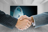 Composite image of business handshake against lock