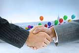 Composite image of business handshake against balloon