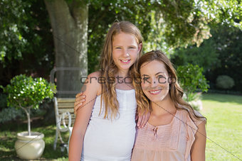 Portrait of happy woman and daughter in park