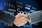 Composite image of business handshake
