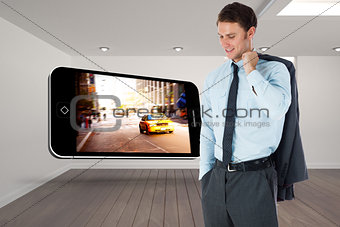 Composite image of smiling businessman holding his jacket