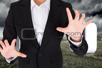 Composite image of businesswoman presenting