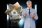 Composite image of businessman holding alarm clock