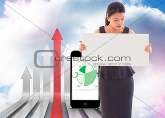 Composite image of businesswoman holding a placard