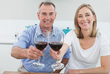 Portrait of a couple holding wine glasses