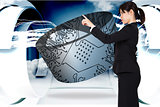 Composite image of serious businesswoman pointing