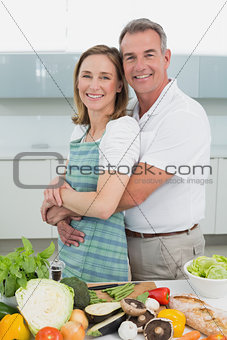 Portrait of a man embracing woman in kitchen