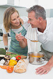 Couple preparing food together in kitchen