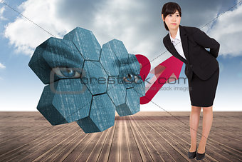 Composite image of serious businesswoman bending