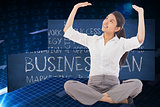Composite image of businesswoman sitting cross legged pushing up