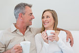 Relaxed loving couple with coffee cups