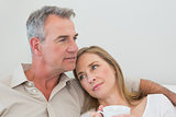 Relaxed loving couple with coffee cup