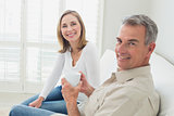 Relaxed couple with coffee cup in living room