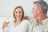 Relaxed couple with a glass of water