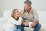 Couple with coffee cup in living room