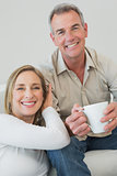 Portrait of a relaxed couple with coffee cup