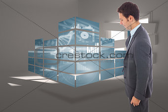 Composite image of cheerful handsome businessman standing