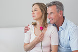 Relaxed romantic couple with a flower at home