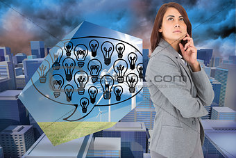 Composite image of concentrating businesswoman