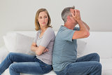 Unhappy couple not talking after an argument at home