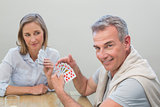 Couple playing cards at home