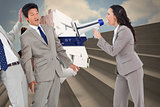 Composite image of businesswoman with megaphone yelling at colleagues