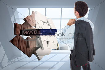 Composite image of businessman holding his jacket