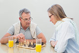 Couple playing chess at home