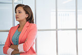 Serious businesswoman looking away at office