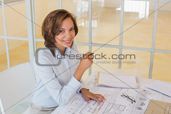 Portrait of confident businesswoman smiling at office