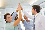 Business team joining hands together in office