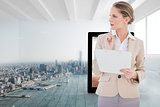 Composite image of pensive blonde businesswoman holding clipboard