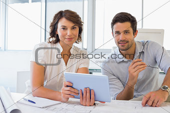 Business people with digital tablet in office