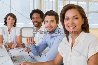 Smiling business people in a meeting at office
