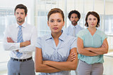 Serious businesswoman with colleagues in office