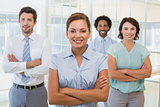 Smiling businesswoman with colleagues in office